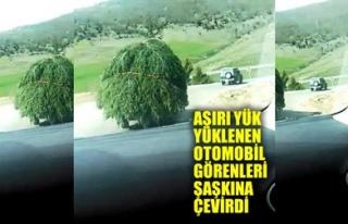 AŞIRI YÜK YÜKLENEN OTOMOBİL GÖRENLERİ ŞAŞKINA...