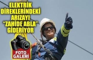 ELEKTRİK DİREKLERİNDEKİ ARIZAYI 'ZAHİDE ABLA'...