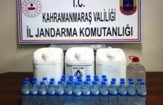 Kırsalda bir evde 44,5 litre kaçak içki ele geçirildi